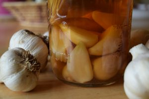 The humble garlic offers powerful health benefits including anticancer, anti-inflammatory, antibacterial, and antiviral properties to combat colds and flu, and much more. Fermenting garlic adds healthy probiotics and offers even greater protective benefits. Making fermented garlic is really simple and here are five easy and delicious recipes for using your homemade, probiotic-rich garlic..